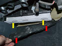 There are six plastic hooks (red arrows, two demonstrated) that fit up through the filter (yellow arrows, two demonstrated) and into the filter housing.
