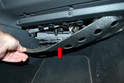 With the screws removed you can pull the insulation piece down from the dash and foot well (red arrow).