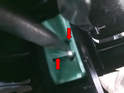 The booster shaft is connected to the back of the brake pedal by several different means.