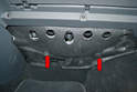 Begin by removing the two plastic screws holding the insulation piece above the passenger side foot well (red arrows, screws removed).