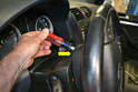 Insert a short screwdriver (yellow arrow) approximately 1/2 inch into the hole.
