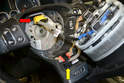 If your steering wheel has controls on it there will be two electrical connections; one for the controls (yellow arrow) and one for the two stage airbag (red arrow).