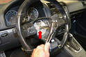 Use a 12mm 12 point and unscrew the circular bolt holding the wheel to the steering shaft (red arrow).