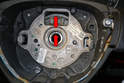 The wheel and steering shaft should come pre marked (red arrows), so that when you install them the wheel is level when driving straight down the road.