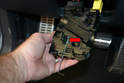 With the module off you can see how the Allen key goes through the access hole and engages the retaining clip (red arrow).
