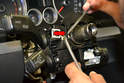Next you will need to insert a thin file, 1mm feeler gauge or something similar between the stalk and the plastic piece around the steering column.