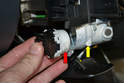 You will need to insert a pick or very small tool between the electrical piece (red arrow) and the barrel (yellow arrow).