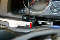 Use a T20 Torx and remove the single T20 Torx screw under the trim piece on the left side of the dash.