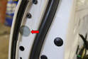 Remove the small piece of tape that covers the access hole for the lock tumbler and handle (red arrow).