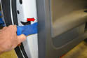 Use a large trim removal tool (red arrow) and gently pry the door panel away from the door.