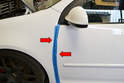 Tape both the leading edge of the door and the trailing edge of the fender to protect the paint when removing the skin (red arrows).