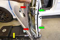 Gently separate the door skin (red arrows) from the frame (green arrows).