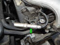 Shown here is one of the spark plug wire/insulators (green arrow) that connects to each spark plug.