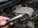 When fitting the new spark plug, carefully thread it in by hand and torque it to 30Nm (22 ft/lbs.