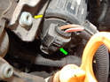 Press the tab (green arrow) on the electrical connector and pull it off the air pump.