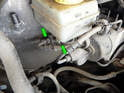 Note the fluid line connections on the left side of the master cylinder (green arrows).
