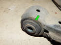 Also be sure to inspect the front bushing for wear (green arrow).