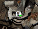 Make a paint mark (green arrow) on the gearshift assembly and shaft.