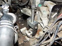 Use a small puller to pop the gearshift assembly of the top of the transmission shaft.
