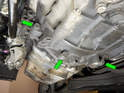 Loosen and remove the three 18mm bolts (green arrows) holding the transmission to the oil pan.