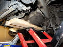 An ATV/motorcycle jack works very well to lower the transmission down and out of the car.