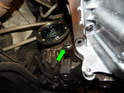 Don't forget to remove the 18mm bolt (green arrow) near the rear of the oil pan.