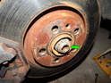 Left and Right Sides - You'll now need to drive the axle out of the wheel hub.