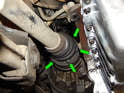 Left Side Axle: Now loosen and remove the six bolts, three at a time (green arrows), locking the axle as described in Picture 5.