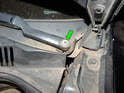 Under each plastic cap is a 13mm nut (green arrow) securing the wiper arm to the motor shaft.