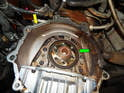 Once the flywheel is removed, take some time to inspect the rear main seal (green arrow) for oil leaks.