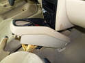 Now carefully maneuver the front of the center console up and out from under the dashboard.