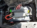 Open the hood and remove the cover on the battery box so you can access the terminals on the battery.