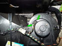 Squeeze the tabs (green arrows) on the electrical connector leading to the blower motor and pull it off.
