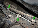 Loosen and remove the three 10mm bolts (green arrows) holding the wiper assembly to the car.