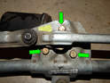 Loosen and remove the three 10mm bolts (green arrows) holding the wiper motor to the wiper assembly.