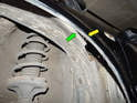 Left and Right sides of car: Now carefully pull the lip of the wheel liner (green arrow) out from behind the edge of the fender (yellow arrow) until you can remove the liner from the fender.