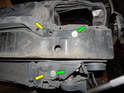 Right Side of Front Bumper: Loosen and remove the two T30 Torx screws (yellow arrows).