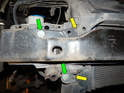 Left Side of Front Bumper: Loosen and remove the two T30 Torx screws (yellow arrows).