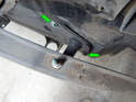 Right Side of Bumper: Loosen and remove the two 13mm bolts (green arrows) holding the rear bumper to the chassis.
