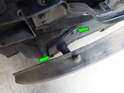 Left Side of Bumper: Loosen and remove the two 13mm bolts (green arrows) holding the rear bumper to the chassis.