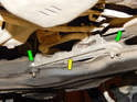 The last step is to loosen and remove the two 13mm nuts (green arrows) holding the rubber mount (yellow arrow) to the chassis.