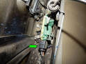 Disconnect the electrical connector (green arrow) attached to the door lock module.