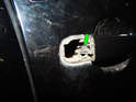 Left and Right Front Doors: Use a small screwdriver to pop the end of the door lock module cable (green arrow) out of the end of the door handle.