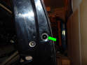 Left and Right Front Doors: Loosen the T20 Torx screw (green arrow) inside the access hole on the doorframe.