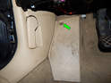 Right A Pillar Panel: Loosen and remove the T20 Torx screw (green arrow) holding the footrest to the floor.
