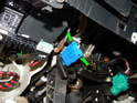 Press the two tabs on the electrical connector (green arrows) inward and pull it off the switch.