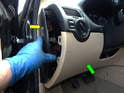 Pull out the side panel covering the fuse box (yellow arrow) and then carefully pull the trim piece (green arrow) off.
