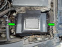 Press the tabs (green arrows) on the sides of the battery cover, and then lift it up and off the battery.