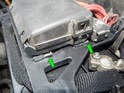 In this picture, you can see the mounting points for the fuse box in better detail (green arrows).