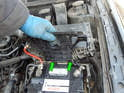 Lift the fuse box support up until you can remove it from the rear pivot points (green arrows).